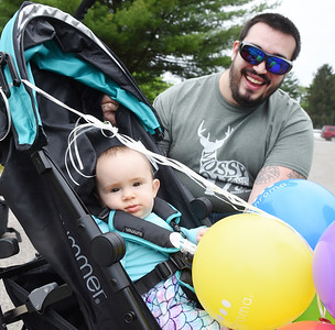 Colby Schukart of West Sunbury was diagnosed as color blind in elementary school. On Wednesday, he received an early father's day gift a pair of color enhancing glasses from his partner Kelly Negron and his daughter 8-month-old Nyx Schukart. Harold Aughton/Butler Eagle