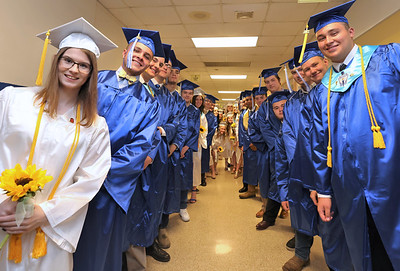 Salutatorian Paige DeHart(left) and valedictorian Brock Jordan (right) get ready to lead out the 2021 graduating class of Union High School Wednesday in Rimersburg. Heavy rains caused school officials to make a last minute decision to move ceremonies indoors. Seb Foltz/Butler Eagle  2021