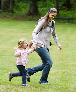 Karen Chill and her daughter, Addison Chill, 2, race through the field at Preston Park during a re-opening ceremony Tuesday morning. Harold Aughton/Butler Eagle.