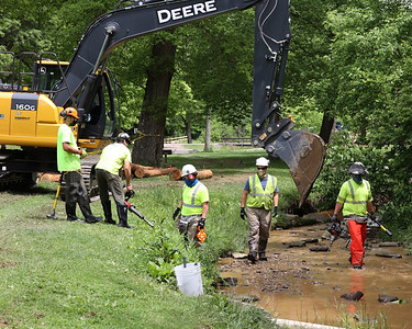 Construction workers contracted by the Connoquenessing River Alliance work on Sullivan Run in Alemeda Park Tuesday. The project -- a joint effort between the county, the alliance and the PA Fish and Game department-- is designed to recreate fish habitat in the stream. Seb Foltz/Butler Eagle 06/01/21