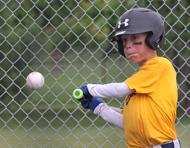 Seth Apthorpe, 9, takes a swing during Mars youth baseball practice Thursday at the Mars Area School District baseball fields off of Route 228. Seb Foltz/Butler Eagle 06/03/21