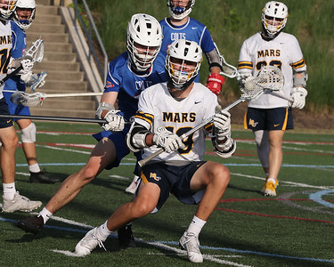 Mars' Wesley Scurci (19) spins away from a defender in the Planet's 18-4 WPIAL Championship win over Chartiers Valley Thursday at Robert Morris University. The win sealed their fith consecutive title. Scurci scored six goals on the afternoon. Seb Foltz/Butler Eagle 05/27/21