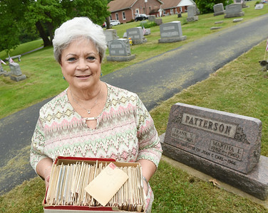 Nancy McClintock holds a box of letters that her grandfather Frank Patterson sent to her grandmother Martha between 1901 and 1905. Harold Aughton/Butler Eagle