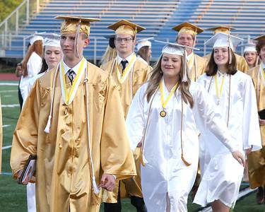 Students walk following Butler High School Graduation Friday night. Seb Foltz/Butler Eagle 06/04/21