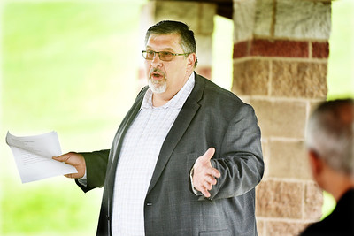 Cranberry Twp. manager Dan Santoro discusses the Route 228 corridor with those gathered at the Butler County Chamber of Commerce's Morning Coffee Club at North Boundary Park Friday morning. Harold Aughton/Butler Eagle