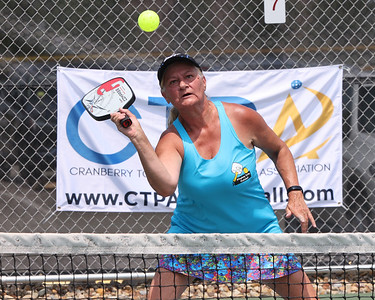 Cranberry Township Pickleball Association member Donna Zukas returns a volley in the weekend's USA Pickleball North Mid-Atlantic Regional Championship at Graham Park in Cranberry. Photo 06/04/21 Seb Foltz/Butler Eagle