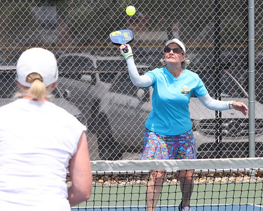 Cranberry Township Pickleball Association member Nancy Brown of Saxonburg returns a volley in the weekend's USA Pickleball North Mid-Atlantic Regional Championship at Graham Park in Cranberry. Photo 06/04/21 Seb Foltz/Butler Eagle