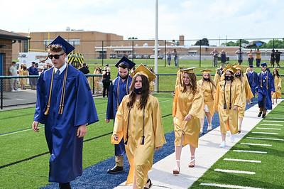 Freeport High School Graduates proceed to the ceremony held at Freeport High School Staduim on Tuesday June 8, 2021 (photo by: Jason Swanson)