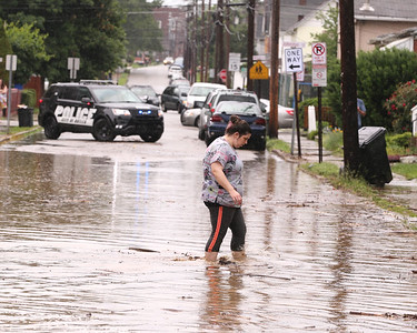 A resident crosses a flooded section of West Brady Street in Butler Wednesday. Seb Foltz/Butler Eagle 06/09/21