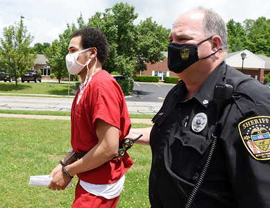 Paris Carter, 22, is escorted by the Butler County Sheriff's deputy into district court in Slippery Rock Wednesday, June 9, 2021. Harold Aughton/Butler Eagle.