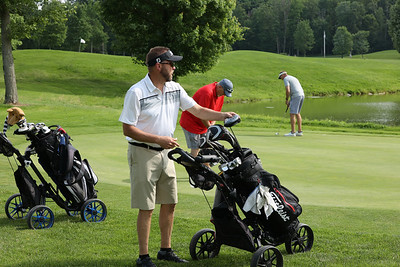 Tim Schoeffel pulls out a club to practice on the putting green prior to Tri-Boro Golf League play Thursday at Krendale Golf Course. Seb Foltz/Butler Eagle 06/10/21