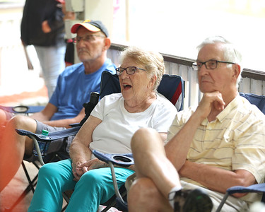 Mary Kay Neely (center) and her husband Bill watch Thursday's Parks and Recreation presentation on the history of Alemeda Park at the parks Carousel Shelter. Seb Foltz/Butler Eagle 06/10/21