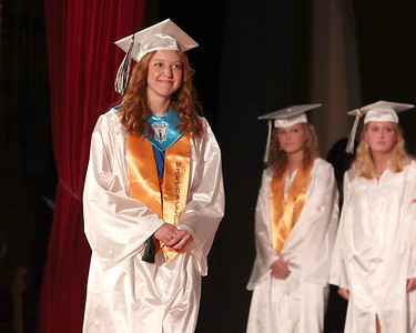 Moniteau High School Valedictorian Jenna Blauser walks across the stage to reciever her diploma at graduation Wednesday. Seb Foltz/Butler Eagle