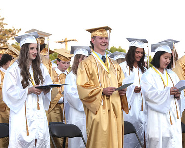 Students stand for the alma mater at the close of  Butler High School Graduation Friday night. Seb Foltz/Butler Eagle 06/04/21