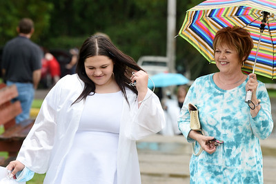 Senior Kirsten Priester, left, and her aunt, Karen Cassin, make their way to Allegheny Clarion Valley High School's graduation ceremony. Harold Aughton/Butler Eagle.