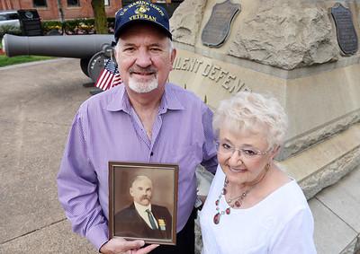 Jim Dixon and his wife, Sharon , hold a photograph Jim's grandfater, Civil War veteran, Jonathan Ireland in Diamond Park. Harold Aughton/Butler Eagle