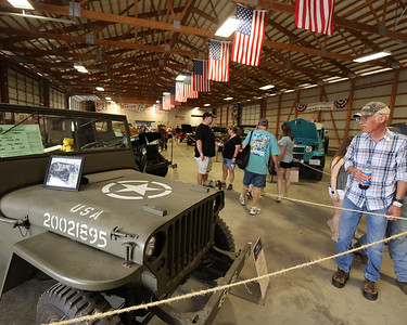 Jeep Fest attendees browse the display of Military and other classic Jeeps on the grounds at Jeep Fest Saturday. Seb Foltz/Butler Eagle 06/12/21