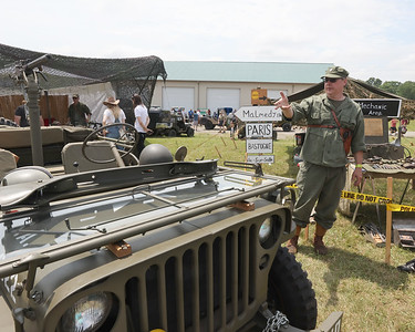 Military Jeep historian David R Hustler explains some of the background on his 1944 Willys Overland Jeep at Jeep Fest Saturday. Seb Foltz/Butler Eagle 06/12/21