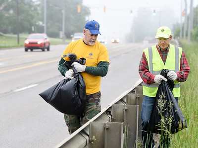 John Hertzog and Mike Winkler of the Butler Lions Club look for trash they found along Route 8 in Center Township Saturday morning. This year marks the 30th year since the Lions Club took part in Pennsylvania's Adopt A Highway program, picking up trash along the two mile section of highway just north of the city. Other participating members included, Connie Ivill, Maryann Fleeger and Adam Fleeger. Harold Aughton/Butler Eagle