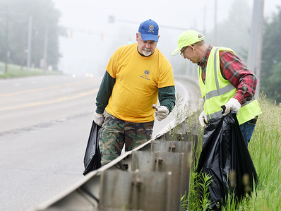 John Hertzog and Mike Winkler of the Butler Lions Club examine a piece trash they found along Route 8 in Center Township Saturday morning. This year marks the 30th anniversary since the Lions Club took part in Pennsylvania's Adopt A Highway program, picking up trash along the two mile section of highway just north of the city. Other participating members included, Connie Ivill, Maryann Fleeger and Adam Fleeger. Harold Aughton/Butler Eagle