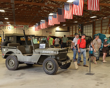 Jeep Fest attendees check out the display of classic Jeeps on the grounds at Jeep Fest Saturday. Seb Foltz/Butler Eagle 06/12/21
