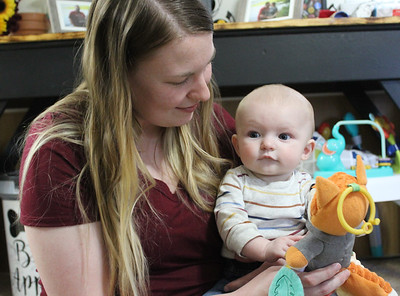 Include these names in Captions: Nora Caughey and her son, Carson Thomas of Cranberry