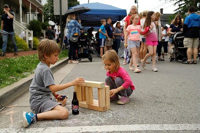 Siblings Ryen (right) and Locke Fletcher enjoy a building session during Wednesday night's Mingle on Main St. in Saxonburg. With storm clouds threatening area residents still turned out in droves to enjoy food trucks and other community festivities before storms rolled through the county. Saxonburgs monthly street fair will continue through the summer. Seb Foltz/Butler Eagle