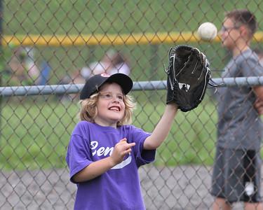 Dean Aufman catches a fly ball during 8U pregame warmups at the Center Township Athletic Association baseball fields Thursday. Seb Foltz/Butler Eagle 06/10/21