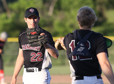 Cranberry relief pitcher Nick Price fist bumps catcher Clayton Blucher after getting out of the top of the fifth inning with runners on base. Seb Foltz/Butler Eagle 06/15/21