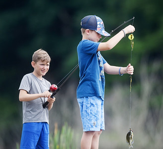 Best friends Ethan Schrecengost, 8, left, and Laydon Darragh, 8, of Middlesex, spent the day fishing at Glade Run with the help of Laydon's mother, Kayley Darragh. The two friends had fun catching and releasing blue gill and small mouth bass.  Harold Aughton/Butler Eagle