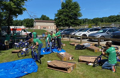Another part of the MSA team shows their bike to a bike expert before it can be loaded into the truck for deliveryHope Hoehler/Special to Butler Eagle