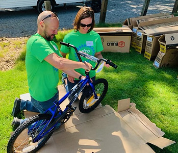 Volunteers from XTO Energy build a bike.Submitted photo