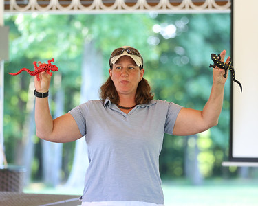Environmental educator April Claus explains some of the kinds of native salamanders to guests at Alemeda Park's Outdoor Discovery Series presentation on amphibians and reptiles Thursday evening. Seb Foltz/Butler Eagle 06/17/21