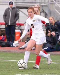 Mars midfielder Ellie Coffield looks to pass down field during Saturday's state playoff game against West Allegheny. Seb Foltz/Butler Eagle