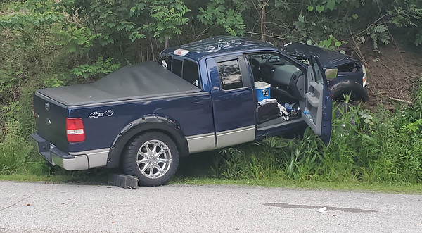 Emergency crews responded to an one-vehicle crash Sunday night involving this truck that drove head-on into an embankment in Center Township. Nathan Bottiger/Butler Eagle