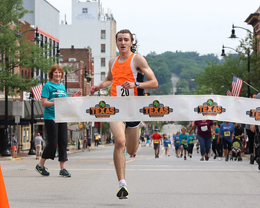 Tim Patterson, 19, finishes first in the men's division of the Butler Road Race 5-mile course. Seb Foltz/Butler Eagle 06/19/21