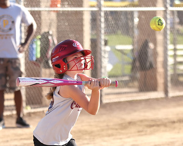 Sydney Thiel, 7, takes a swing at a pitch during a Cranberry Township 8u softball game at Graham Park Tuesday evening. Thiel hit a single on the play. Seb Foltz/Butler Eagle 06/15/21
