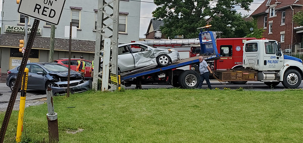 Caption: Police, firefighters and EMS responded to a two-vehicle crash Sunday afternoon at the intersection of Monroe and East Jefferson Streets in Butler. Nathan Bottiger/Butler Eagle