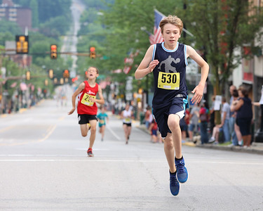 Logan Rogers, 12, finished first in the under 10-13  age group of the Butler Road Race 2 kilometer course Saturday. Seb Foltz/Butler Eagle 06/19/21