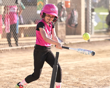 Lyla McElravy, 7, hits off the tee during a Cranberry Township 8u softball game at Graham Park Tuesday evening. Seb Foltz/Butler Eagle 06/15/21
