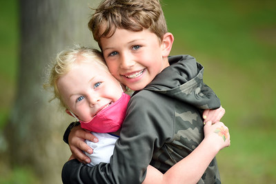Siblings Henley, 5, and Rory Kerr, 7, shared a hug during an unexpected meeting during the Kids on Campus summer program at the Butler County Community College Tuesday morning. Harold Aughton/Butler Eagle.
