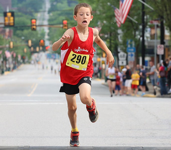 James Christian, 9, finished first in the under 10 age group of the Butler Road Race 2 kilometer course. Seb Foltz/Butler Eagle 06/19/21