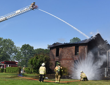 Firefighters from Saxonburg and Butler Twp. battle a structure fire at 995 Saxonburg Road Thursday afternoon. According to Saxonburg Fire Chief Christopher Dean there were no injuries caused by the fire. Harold Aughton/Butler Eagle