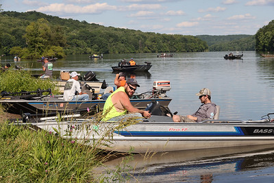 Travis Gates(right) and Zach Boring wait for the start of Wednesday's Butler Bass Casters' weekly evening fishing tournament series. Seb Foltz/Butler Eagle 06/23/21