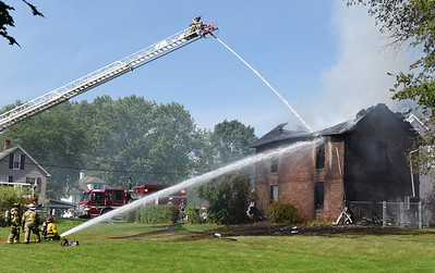 Firefighters from Saxonburg and Butler Twp. battle a structure fire at 995 Saxonburg Road Thursday afteroon. According to Saxonburg Fire Chief Christopher Dean there were no injuries caused by the fire. Harold Aughton/Butler Eagle