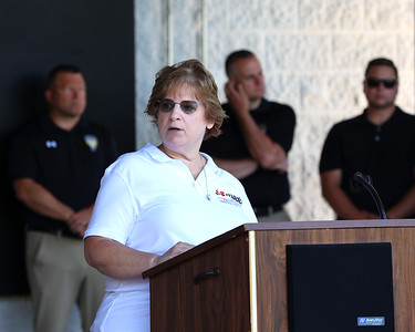 Natalie Parkinson of Butler speaks during Wednesday's mobile DUI Victim Memorial  Wall ceremony in Cranberry Township. Parkinson's  daughter Renee died in a car accident when a drunk driver struck her vehicle near the Warrendale exit on I-79 following Fourth of July celebrations in 2007. 06/24/21 Seb Foltz/Butler Eagle 06/24/21