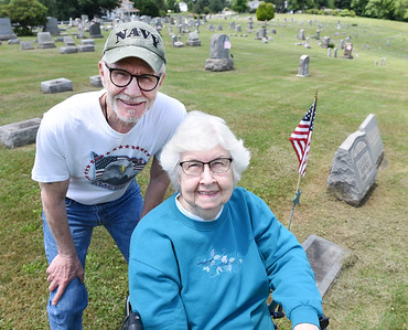 James Burtner and his sister Eva Jean Ohl by the grave of their grandfather, John Burtner, who was in the Civil War. Harold Aughton/Butler Eagle