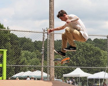 Jeremiah Schmidt, 24, of Butler attempts a trick during competition at Father Marinaro Skate Park Saturday. Seb Foltz/Butler Eagle 06/26/21