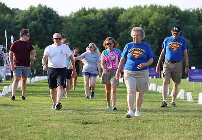Walkers participate in Saturday's Relay For Life cancer awareness walk in Cranberry's North Boundary Park. Seb Foltz/Butler Eagle  June 26, 2021