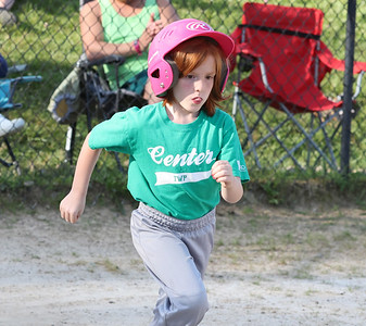 Ryanne Miller, 6, runs to first after a hit in a 4-6 Center Township baseball game this week. Seb Foltz/Butler Eagle 06/23/21
